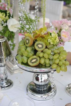 Jenna would love this! green, green, green - edible centerpiece with grapes and kiwi fruit.