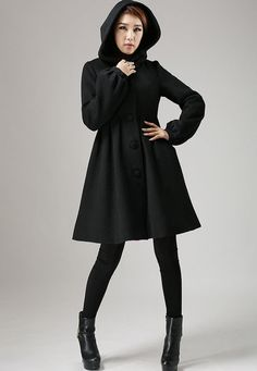 This is a black wool coat with hood.      Wool blend fabric, and Polyester Lining  hooded neck Long sleeve style  button fastening through the front