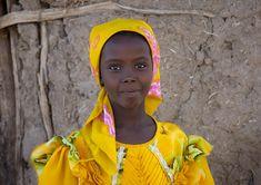 Africa | Afar girl in colourful dress. Asaita, Danakil, Ethiopia | © Eric Lafforgue
