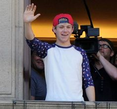 Niall waving to fans by his hotel room window in Milan - May 20, 2013