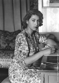 1944: Queen Elizabeth II (as Princess Elizabeth) writing at her desk in Windsor Castle, Berkshire