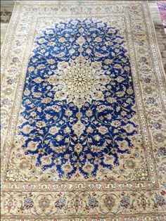 Silk Persian carpet.