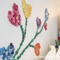 A small bite of mondocherry: diy wall design with buttons...