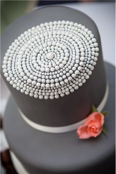 Claire Kemp Cake Studio :: With designs influenced by contemporary art, architecture, fashion and graphics, Claire Kemp Cake Studio offers a fresh interpretation of wedding cake design.