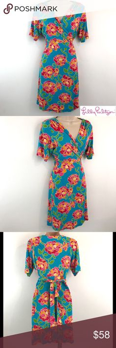 """Lilly Pulitzer Floral Wrap Dress Short Sleeve Lilly Pulitzer   Floral Pattern Wrap Dress  Short Sleeve  Women's Size Medium   Pre Owned Dress, in Good Shape. Some signs of being worn  No Holes, Stains or Fading   Total Length:37""""  Sleeve Length:10""""  Underarm to Underarm:17.5""""   Item comes from a pet free/smoke free clean environment  please contact me for any additional questions  I offer combined shipping Lilly Pulitzer Dresses"""