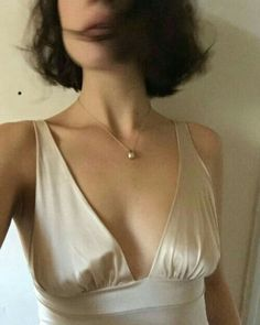 Silk cream camisole plus a bit of blur.