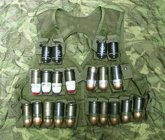 """""""Vest full of ammunition for the Grenade Launcher. This is the type of vest I had in Vietnam for my launcher."""" Quote by Randy Bordner M79 Grenade Launcher, Samsung Digital Camera, Combat Medic, Vietnam War Photos, Fire Powers, Military Weapons, Military Equipment, Special Forces, Cold War"""