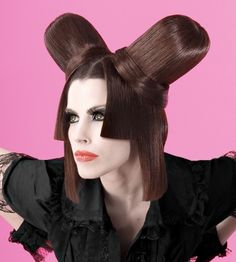 A long brown straight sculptured quirky avant garde updo hairstyle by Mikel Luzea