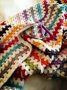 So pretty. Alternate between cream and slightly muted colours <3 | Crocheted granny stripe blanket