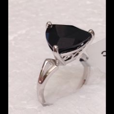 LTD ED 11.01 CT Black Spinel 'The Black Diamond ' LTD EDITION 11.01 CT Black Spinel often called the black diamond due to its brilliant shine.  NEW Genuine Black Spinel, the rarest among all spinel. 1/200 rings made. Huge 11.01 CT in a trillion (triangle) cut. Set in .925 Sterling Silver. Size 8, can be sized up or down two sizes. Completely natural gemstone. Certification of Authenticity. Jewelry