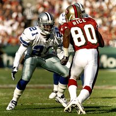 2011 Hall of Fame inductee Deion Sanders in action against Jerry Rice. (Getty Images)