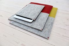 iPad mini case in grey and yellow and red wool felt for MacBook Pro. Handmade felt sleeves. Basic and smart protection.