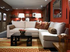Colorful and Inspiring.    By combining modern finishes and fixtures, exotic colors and fabrics, and ... some areas are painted a peppery, reddish-orange color, while the rest are papered in a heavy, textured grass cloth. For the floors, Candice uses a hard-wearing vinyl that looks like hardwood, but is more durable and perfect for basements.