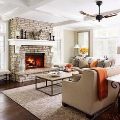 Nice, neutral color palette with splashes of color!  Love the fireplace in this great room/family room!