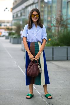 A simple button-down pairs perfectly with a structured midi skirt and fancy pool slides. #refinery29 http://www.refinery29.com/midi-skirt-outfits#slide-6