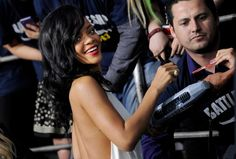 "Rihanna, a cast member in ""Battleship,"" turns back for photographers as she signs autographs at the premiere of the film, Thursday, May 10, 2012, in Los Angeles. The film is released in theaters this Friday, May 18."