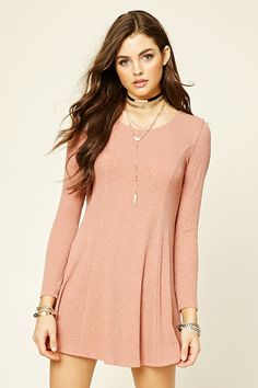 Style Deals - A ribbed knit mini dress featuring a skater silhouette, strappy self-tie back, round neckline, and long sleeves.