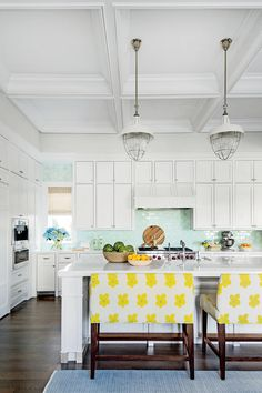 30 Kitchen Lighting Ideas That'll Transform Your Space | These white industrial pendant lights add a vintage edge to this playful kitchen. #homedecor #decorideas #southernliving #kitchendecor #kitchenideas