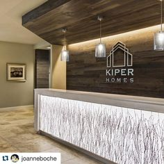 #Repost @joanneboche ・・・ Kiper Homes - custom reception desk with backlit #3formvaria Organic Birch Grove inset surrounded by #greyne wood plank feature wall and soffit.  #3form #greynecompany #interiordesign