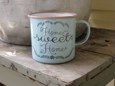 Add a touch of beauty to your decor with this Home Sweet Home mug. Find other accents to complete your primitive home here at the Quilt Shop. https://www.primitivestarquiltshop.com/collections/farmhouse-primitives/products/home-sweet-home-mug #primitivefarmhousedecor
