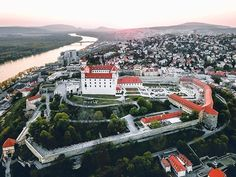 Bratislava Castle - Pressburger Schloss - Pozsonyi Vár is the main castle of Bratislava, Slovakia. The building with four corner towers stands on an isolated rocky hill of the Little Carpathians directly above the Danube river in the middle of Bratislava. Because of its size and location, it has been a dominant feature of the city for centuries. The location provides excellent views of Bratislava, Austria and parts of Hungary. Many legends are connected with the history of the castle. Rocky Hill, Bratislava Slovakia, Danube River, Big Country, Most Beautiful Cities, Drone Photography, Eastern Europe, Paris Skyline, The Good Place