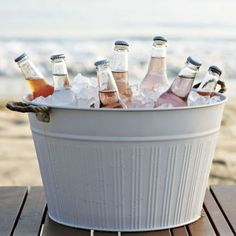 Outdoor Metal Drink Bucket - $29.00 »  Keep those beers icy cold and accessible in this classic drink bucket. I love the rope handles.