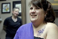 A breast cancer survivor heals emotionally thanks to her scar-concealing tattoo.  http://thestir.cafemom.com/healthy_living/145399/20_awesome_tattoos_supporting_breast