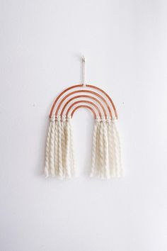 Rainbow Wall Hanging | Rainbow Decor | Metal Wall Hanging Featuring a rainbow design in the metal of your choice, paired with knotted 100% recycled peruvian wool twisted yarn fringe, so soft to the touch. Our metal pieces start as Rare Bird original designs, that are laser cut out of