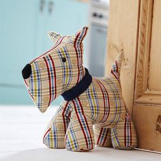 Shaped door stop designed by Ulster Weavers.  Our door stops make the perfect gift to make any house a home, in fact they are a great, alternative housewarming gift. The cute characters liven up any room and make a much better addition than a boring old door wedge. With designs and colours to suit a multitude of tastes you will be able to stop doors from banging in style!Cotton with sand & polyester filling. Sponge clean only.Height 26 cm x Base 27 cm