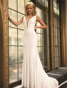 Style 22884 from Jovani is a gorgeous sleeveless jersey prom dress that features a plunging neckline and back.
