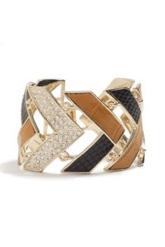 a python-print and rhinestone bracelet