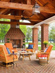 Architectural Elements Unite This Covered Patio To The Home, As Do The  Ceiling Fan, Chandeliers, Upholstered Furniture And Fireplace.