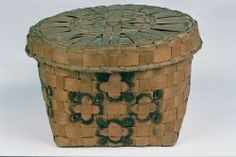 """Covered basket woven of 3/4-1"""" splints. Square base, circular top. The four sides are decorated in a free-hand, painted  design of pink and black four-lobed medallions. Four of these medallions placed in circular fashion form the side decoration. The center of the circular cover has a similar design.Probable Datec. 1830"""