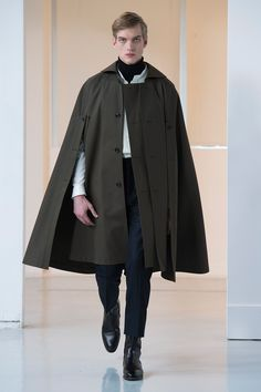 8. Cape in compact cotton gabardine, overshirt in lightweight wool crepe, turtle neck sweater in extrafine wool, suit pants in heavy wool flannel, boots in leather