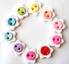 All buttons are 3/4 inch and double glazed for a glossy shine.The flowers on these buttons are a bit different than the other rainbow flowers. If adding to clothing I recommend hand washing or gentle cycle in cold and hang to dry.
