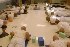 Participants in Yoga Behind Bars' Teacher Training for Prisoners practice yoga with instructors Laura Prudhomme and Dawn Hanson at Stafford Creek Corrections Center.