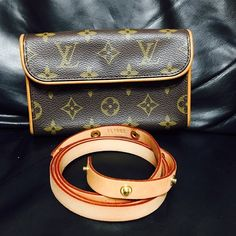 Authentic florentine waist bag LV Authentic and well-loved Louis Vuitton Florentine waist bag. In very good condition. No tear, holes or rip in the canvas. Bag serial number is FL0053 and belt serial number is FL1002 both made in France. Louis Vuitton Bags Clutches & Wristlets