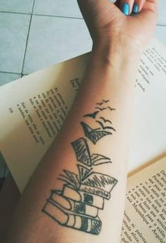 Flying books tattoo
