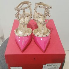 Valentino Garavani Rockstud fuschia hot pink heels Brand new never used.  10000% Authentic!  Comes with original box, dustbag, booklet, and tissue shoe stuffing.  Willing to sell lower on other apps.  Size 39.5 euro  Rare discontinued color! Valentino Shoes Heels