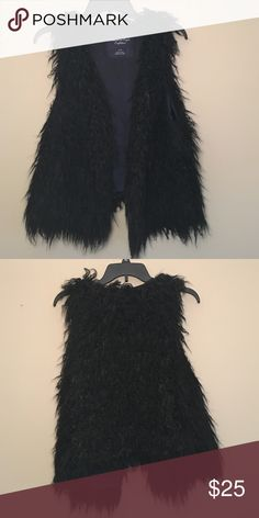 American Eagle Fur Vest Great condition! Black fur vest with 3 hidden hooks and loops to hold the two sides together. American Eagle Outfitters Jackets & Coats Vests