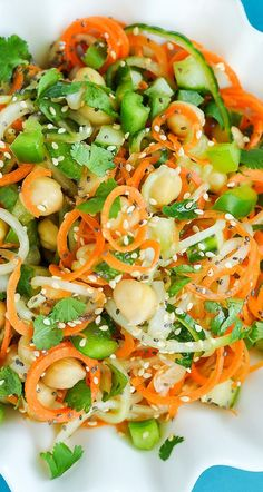 Healthy Spiralized Sweet + Sour Thai Cucumber Salad with Carrots, Chickpeas, and Cilantro - we're obsessed with this one!