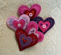 felt heart brooches - great idea to add buttons and detailed stitching for the more able at the party!