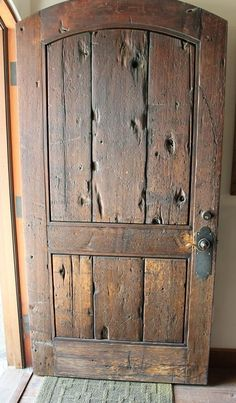 large solid wood front door, distressed and rustic
