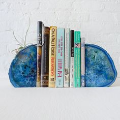 Striking stone bookends add color and interest to the shelf.