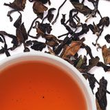 Golden Dragon Oolong--Unusually lush, fruity, and floral fragrance with a sweet, delicate taste. Hand-twisted whole leaves.