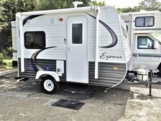 2016 New Travel Lite E14 Travel Trailer in Florida FL.Recreational Vehicle, rv, PRICED TO SELL@ JUST OVER FACTORY INVOICE this NEW 2016 E14 Travel Lite Express travel trailer weighs only 1785 lbs. dry weight and can be pulled by most 6 cylinder cars / vans/ trucks. Perfect for the couple wanting a small light weight Rv fully self contained. It has beautiful cherry tone cabinetry and Bellefleur Woodland decor interior. It is also equipped with a 12,000 BTU furnace, 2 burner gas stovetop, a…