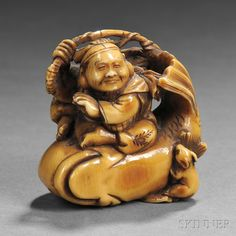"""Ivory Netsuke of Ebisu, Japan, 19th century, seated on fish hanging from his fishing rod, with a mouse nibbling on the fish, signed """"Kazumasa"""" to base, ht. 1 1/2 in."""