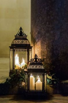 beautiful vintage lanterns with wax candles and greenery. for weddings, parties or home decor accents