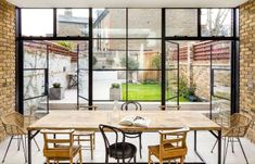 Crittal doors and exposed brickwork with a contemporary kitchen Glass Extension, Rear Extension, Extension Ideas, Edwardian Haus, Crittal Doors, Crittall, Open Plan Kitchen Living Room, London House, Shaker Kitchen