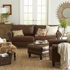 Genius is in the details, and our Alton Collection has a special genius for relaxation. Padded, rolled arms, bonded leather and extra-thick removable cushions give the Alton Armchair an indulgent feel. Underneath, a hardwood frame provides durability and integrity. As for the turned legs and nailhead trim? Well, sometimes even geniuses have to show off.